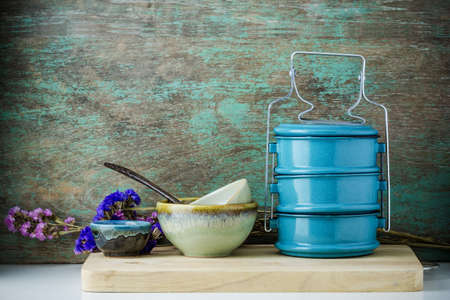 tiffin: Metal tiffin, Thai food carrier on wooden background. Stock Photo