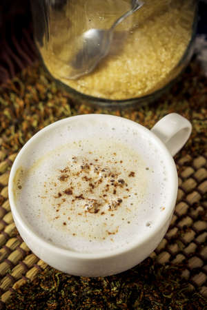 mocha: Cup of mocha coffee on plate mat