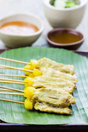 peanut sauce: Grilled Pork Satay with Peanut Sauce and Vinegar, Thai food.
