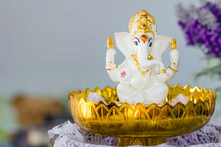 Ganesha Hindu God statue on tray with pedestal