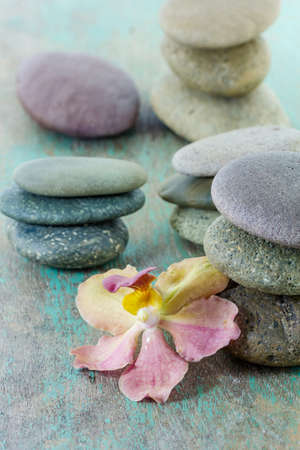 details: spa concept with zen stones and orchid on wooden background Stock Photo
