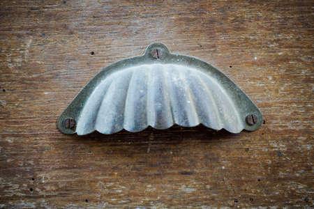 old desk: Close up of a metal handle on old desk drawer