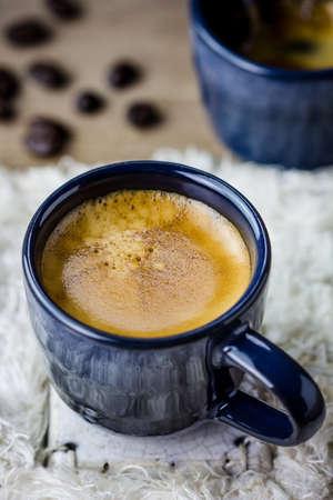 white napkin: Two cups of espresso on white napkin