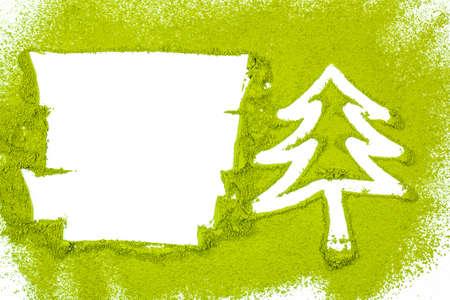 green powder: Christmas tree with powdered green tea on white background