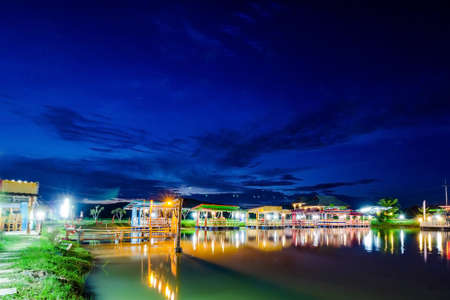 house float on water: Colorful houseboat village on Lake in Chiangrai, Thailand