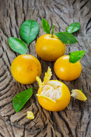 japonica: oranges (Citrus Japonica Thunb) on a wooden background Stock Photo