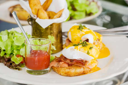 buttery: Eggs Benedict- toasted English muffins, ham, poached eggs, and delicious buttery hollandaise sauce