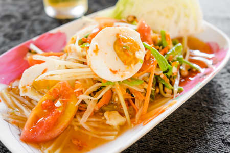green papaya salad: Green papaya salad with salted egg. spicy thai food Stock Photo