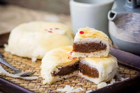 Homemade mooncake and tea,Chinese mid autumn festival food.