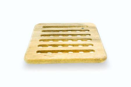 trivet: round wooden trivet isolated on white background