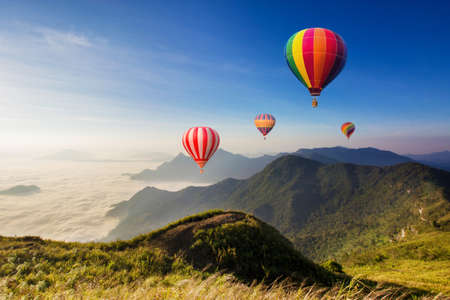 hotair: Colourful hot-air balloons flying over the mountain
