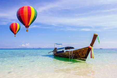 hotair: Colourful hot-air balloons flying over the sea at Krabi, Thailand.