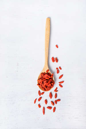 wolfberry: Goji berry or Chinese wolfberry in wooden spoon on wooden background