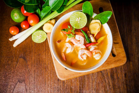 Tom yam kong or Tom yum, Tom yam is a spicy clear soup typical in Thailand and No.1 Thai Dish Cuisine. Thai food.