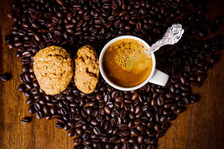 whole grains: Cup of coffee with whole grains cookies Stock Photo