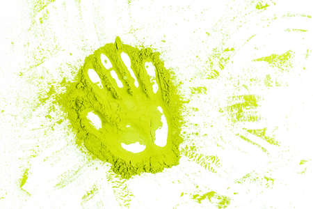 green powder: green powder forming hand shape surface close up background
