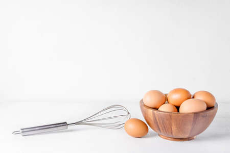 Egg in a wooden bowl on wooden table . Chicken Egg.