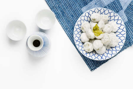 Coconut pandan ball in ceramic bowl on table