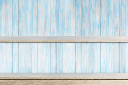 store shelf: Empty wood shelf on blue wooden wall Stock Photo