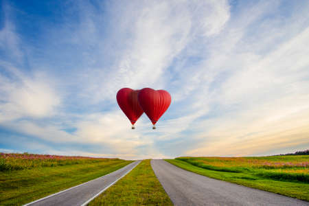 Beautiful Red balloon in the shape of a heart at sunset Stock Photo