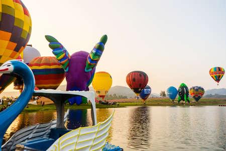 CHIANG RAI, THAILAND - FEBRUARY 14, 2018: SINGHA INTERNATIONAL BALLOON FIESTA 2018. The colorful of hot air balloon festival at the Singh Park in Chiang Rai