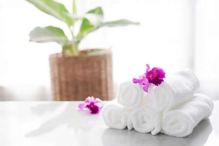 Towels on table with copy space blurred bathroom background. For product display montage. Standard-Bild