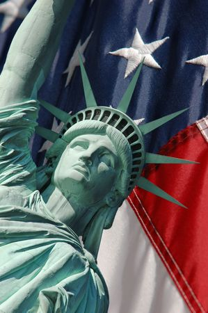 The Statue of Liberty super-imposed on the draped Stars and Stripes
