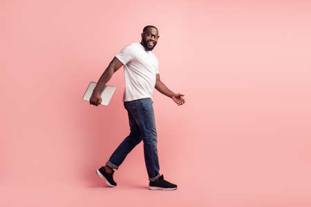 Young smiling african man walk carry laptop