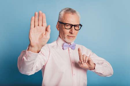 Photo of elegant man holding finger and palm raised ignoring somebody