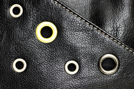 Black leather background with studs photo