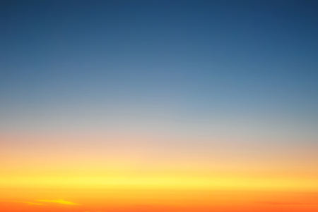 background, clear sky above the clouds, at sunset, view from the window of an airplane Stockfoto