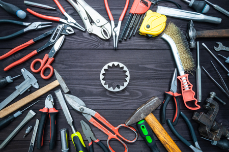 Tool gears and heart on a dark wooden background. Concept Love for your work, Fathers Day. Imagens