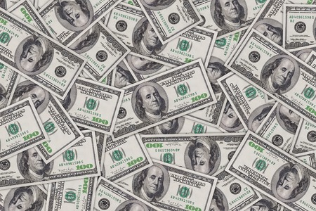 Background from a lot of one hundred dollar banknotes