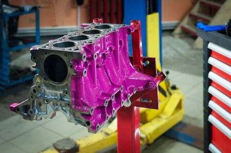 the car cylinder block in workshop. engine overhaul in a small service