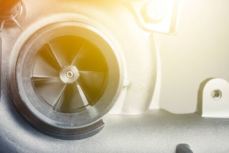 new turbine of car on white background. close up impeller Stock Photo