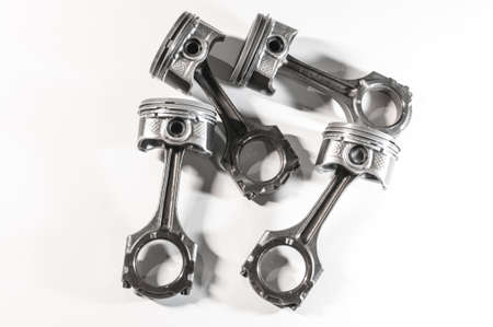 new pistons with connecting rod engine car on white background