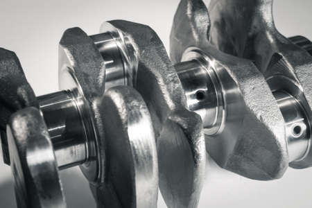 new shiny silver crankshaft on white background. Close up Stock Photo