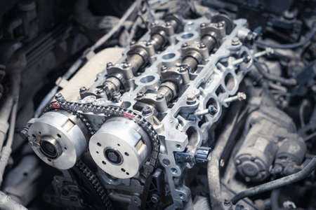 the new car timing chain on a disassembled engine in a car workshop