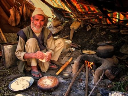 atta: Indian man making food