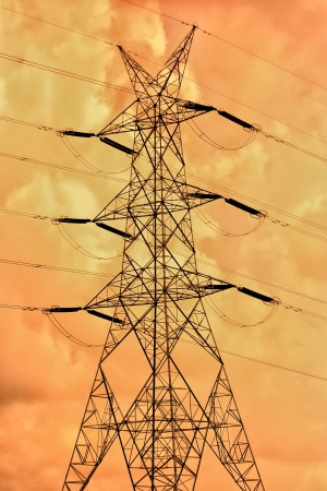 transmission line: Vector silhouette of high voltage electric line against  sky Stock Photo