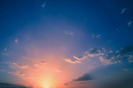 Scenic orange sunset sky background Stock Photo