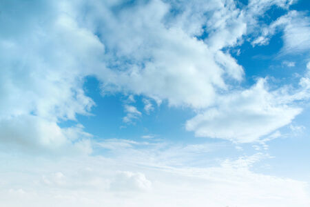 blue sky background with tiny clouds photo