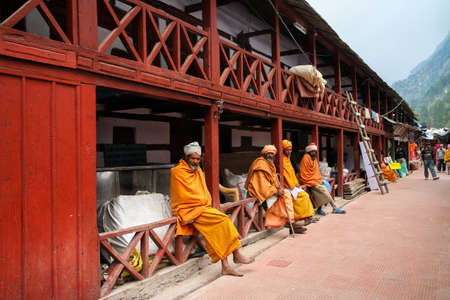 Gangotri, Uttarakhand, India - May 08, 2012 : Sadhus sitting at way to gangotri temple. Normally a sadhu is a monk, renounced, renounced material enjoyment. In India from 4 to 5 million sadhu. 에디토리얼