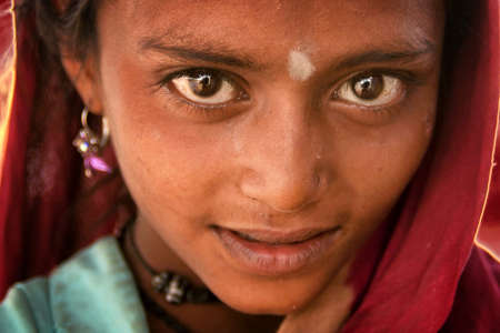 Somnath, Gujarat, India - February 24, 2012 : poverty, portrait of a poor little Indian girl.