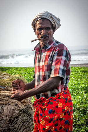 Kovalam, Kerala, India – October 17, 2007 :  Portrait of an unidentified local fisherman in traditional attire at Kovalam coast in Kerala