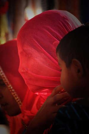 A young Rajasthani woman in veil at Pushkar Mela (Pushkar Camel Fair), Rajasthan, India. Editöryel