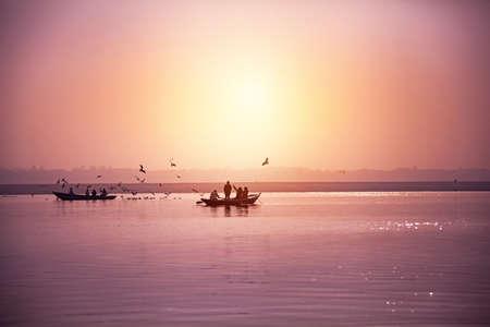 Hindu priests perform an Arti worship ceremony at  Ganges River, Varanasi, Uttar Pradesh, India