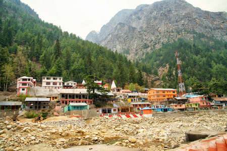 View of Gangotri town with mountains and holy ganga river. Uttarakhand, India.