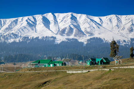 A picturesque view of Snow Covered Himalayan Mountains and pine tree lands in Gulmarg, Jammu and Kashmir, India Stok Fotoğraf