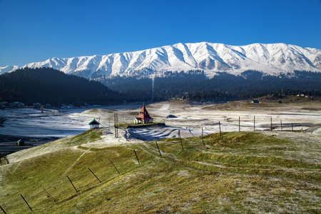 Lord Shiva temple amidst plain lands of Himalayan Mountains in Gulmarg, Jammu and Kashmir, India